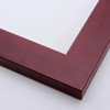 This simple wood frame with a deep mahogany wash highlights the natural wood grain and features a stepped inner lip.