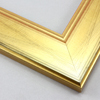 This wide, simple frame features solid wood construction overlaid with brushed gold foil.  A subtle wave pattern on the smooth face lends a modern edge to this classic style.