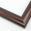 This shallow reverse scoop frame features a smooth face in a deep mahogany wash with a subtle view of the natural wood grain. The inner lip is a horseshoe relief design in black, and the black outer edge has a slight bevel.