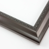 This shallow reverse scoop frame features a smooth face in a dark walnut wash with a subtle view of the natural wood grain. The inner lip is a horseshoe relief design in black, and the outer edge has a slight bevel.