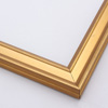 This narrow frame features a crown moulding profile finished in gold leaf.  An antique look is achieved with a gentle brushed effect that highlights the corners of the bevelled edges.