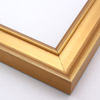 This frame features a deep crown moulding profile finished in gold leaf.  An antique look is achieved with a gentle brushed effect that highlights the corners of the bevelled edges.