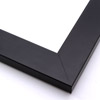 This simple, matte black frame features straight edges and a narrow, stepped lip.  